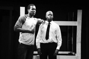 "IN THE MOMENT - Actor Terrance Colby Clemons clutches his chest with great distress as his character, Wade, struggles to pull himself together. The actor duo portray two interviewees for a construction jobin alumna Julie Taiwo Oni's ('06) play ""BUNK."""