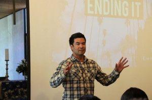 "Guido Hajenius, the Los Angeles regional hub coordinator of iEmpathize, gives a multimedia presentation on ""Ending It.""   Photo by Sacha Irick"