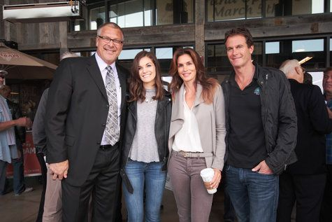 Eric Fuchser (left) the market manager, and his daughter, Hannah Fuchser, pose with Cindy Crawford and Rande Gerber (right).