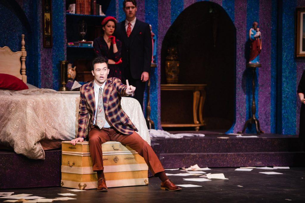 Trickster Gianni Schicchi (Jack Gerding) outlines his plan to change the will of a family's deceased relative. The fast-paced Italian comedy is the second of two one-act performances that constitute this year's opera.