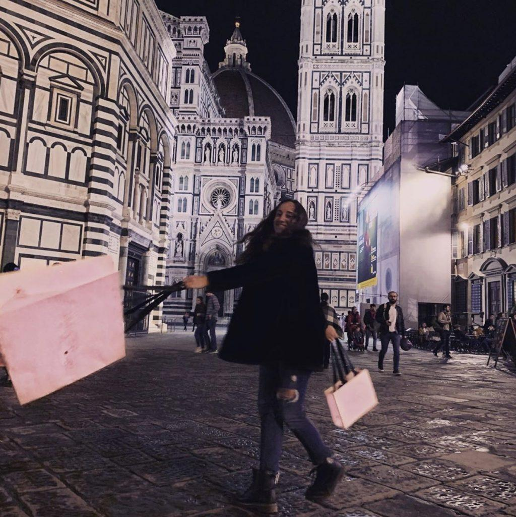 Sophomore Emily Lucente swings shopping bags around at Piazza Del Duomo in Florence, Italy. Photo courtesy of Emily Lucente