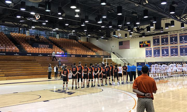 An abnormally sparse crowd stands for the national anthem prior to Pepperdine Men's Volleyball's match March 12 at Firestone Fieldhouse. The Waves defeated Jamestown 3–0 in the first, and only, Athletics event with attendance restrictions. Little did the teams know, it would be the final Athletics event at Pepperdine for the remainder of the spring 2020 semester. Photo by Karl Winter