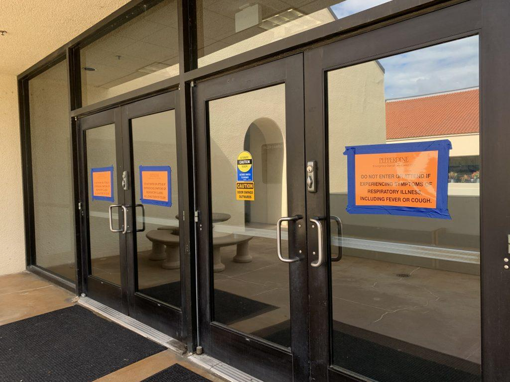 "Signs that read ""Do not enter or attend if experiencing symptoms of respiratory illness, including fever or cough"" are posted on all entrances to Pepperdine buildings."