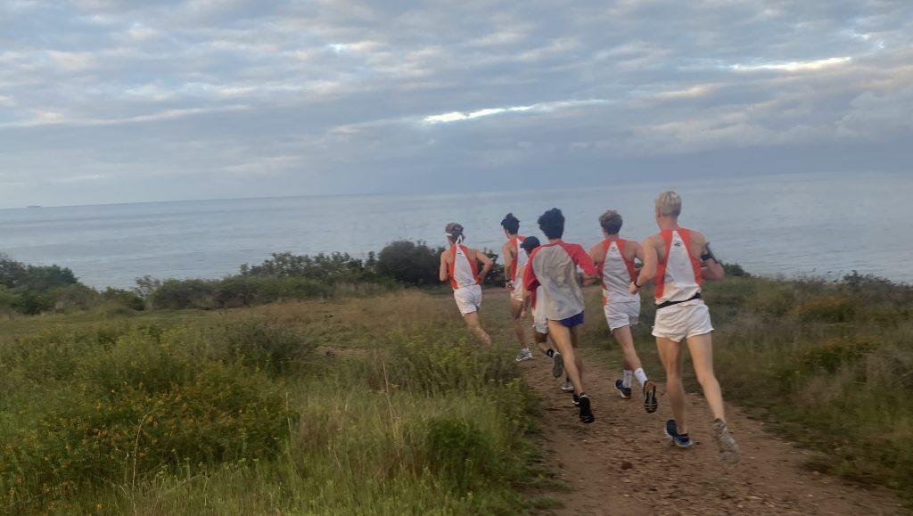 Members of Pepperdine's Men's Track team run down the Malibu Bluffs on Sunday. Seven of the team members ran 26.2 miles from Pepperdine's campus to Playa del Rey as a final act of closure for the seniors. Photo courtesy of Preston Gromer