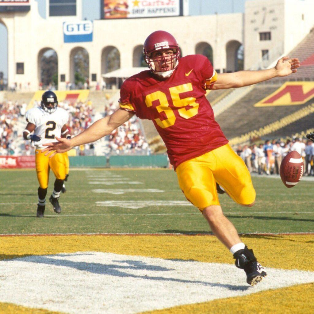 Papadakis celebrates a rushing touchdown versus Cal Berkeley in the L.A. Memorial Coliseum in 2000. Photo courtesy of @theoldp on Twitter