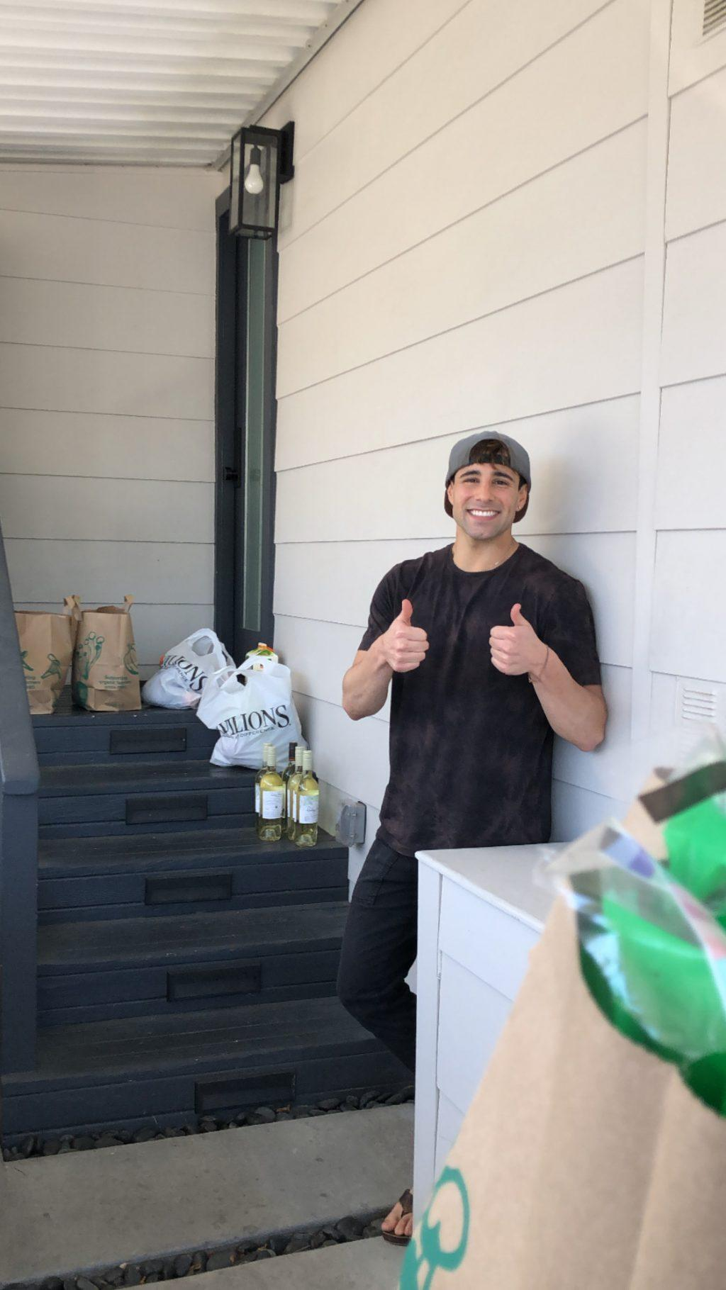 Zeke Bongiovanni delivers four bags of groceries from Whole Foods and Pavillions to his client's front steps March 21.