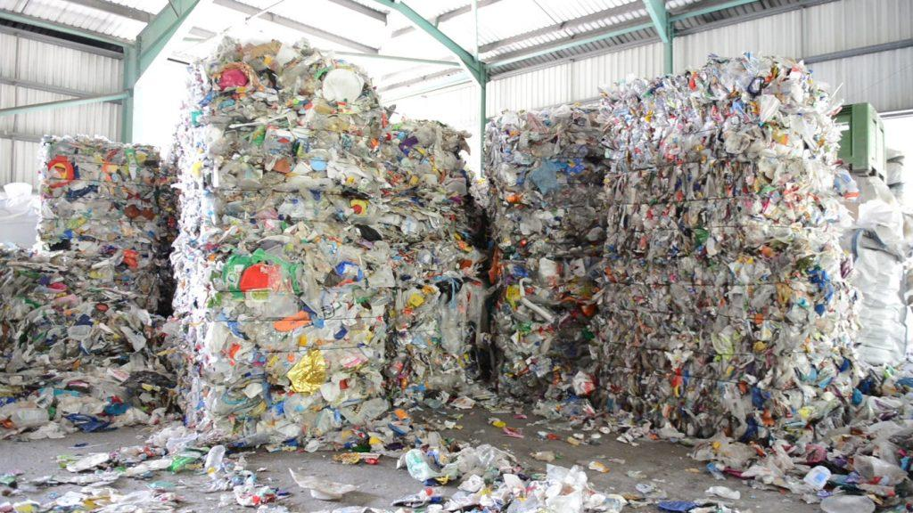 Baled plastic waste sits in a U.S. storage space. The U.S. has scrambled for the past two years to deal with the millions of tons of plastic waste it used to send to China until China cut off the recycling industry in January 2018. Photo courtesy of NPR