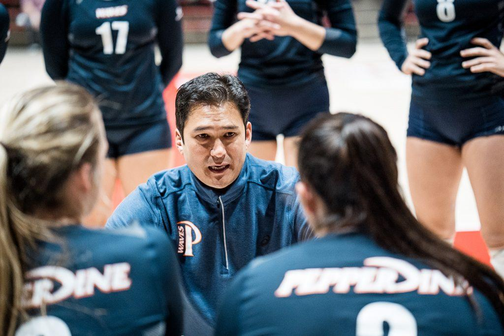 Women's Volleyball Head Coach Scott Wong speaks to his team during a timeout. Wong said the COVID-19 has not affected contact with high school junior and senior recruits, but it has been challenging to make contact with sophomores. Photo courtesy of Mark Burch | Pepperdine Athletics