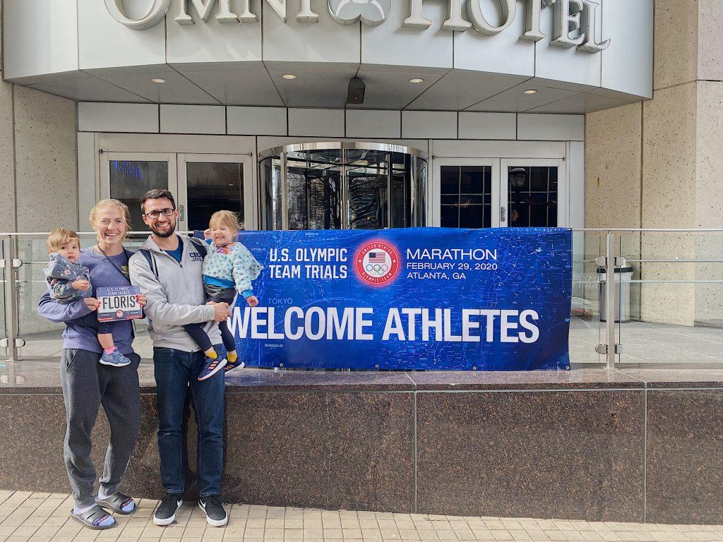 The Floris family poses in front of the athlete hotel in Atlanta.