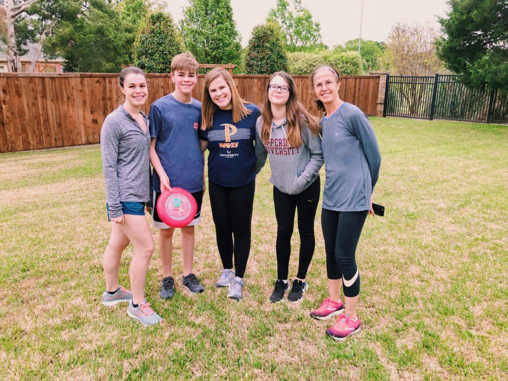 Kelli Brickner (middle) plays a game of frisbee with her siblings. Since leaving Pepperdine and returning to her home in Texas, Brickner enjoys getting fresh air and spending time with her family. Photo Courtesy of Kelli Brickner