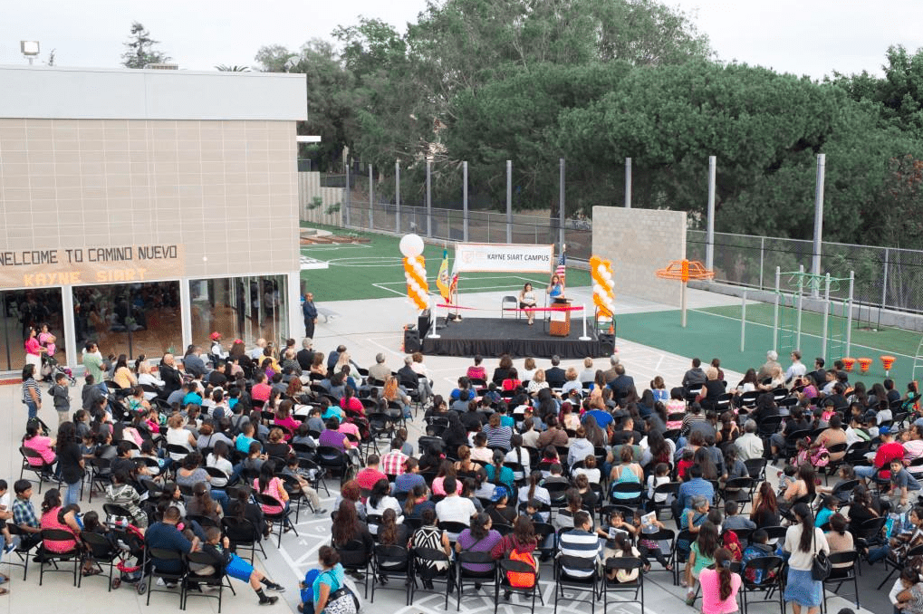 Community members gather at Molly Stoeckel's school, Camino Nuevo Kayne Siart Campus, for a ribbon-cutting ceremony. Photo courtesy of Kayne Siart's Website Photo Gallery