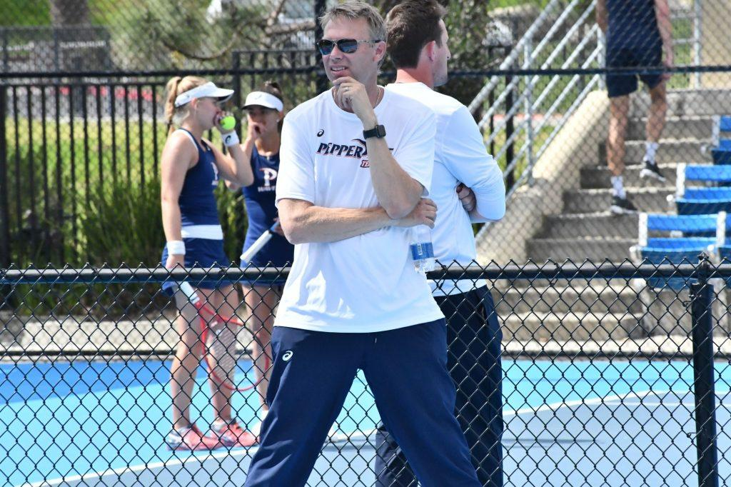 Women's Tennis coaches Per Nilsson (front) and Pete Billingham (back) watch doubles matches at the Ralphs-Straus Tennis Center. Nilsson said that the break from intense training could be positive for tennis players. Photo courtesy of Sarah Otteman | Pepperdine Athletics