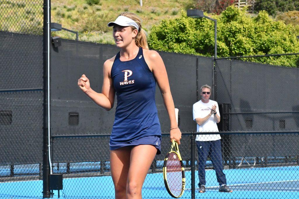 Lahey celebrates her victory in a dual singles match against No. 4 Texas on Feb. 28 in Malibu, as Head Coach Per Nilsson looks on. The Waves would win the match 7–0. Lahey finished the spring season with only one singles loss. Photo courtesy of Pepperdine Athletics