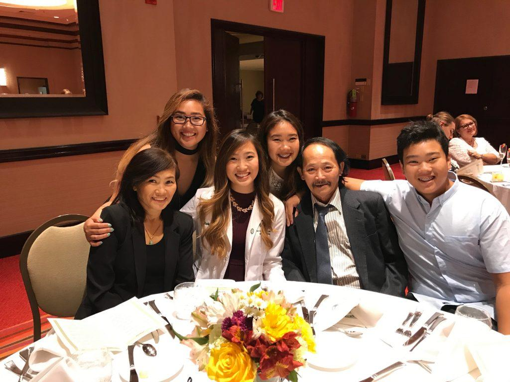 Garden Grove resident Amy Than smiles with her family at her sister's white coat ceremony in Puerto Rico. Than said she is scared her parents may be targeted and face discrimination in public because they do not speak English. Photo courtesy of Amy Than