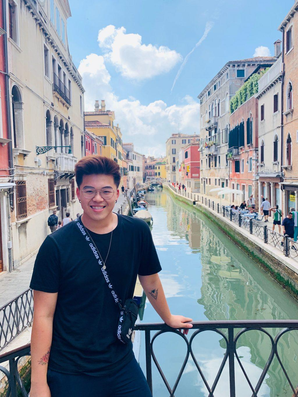 Alhambra, California resident Derek Wu stands next to a canal in Venice, Italy during his study program with the University of California Riverside. Although he lives in a predominantly Asian community, Wu said he feels self-conscious of his race and ethnicity when he goes go to places where Asian Americans might not frequent. Photo courtesy of Derek Wu.