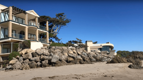 A rock wall wards off waves in front of a Malibu mansion on Broad Beach. Photo by Jenna Gaertner and Brianna Willis