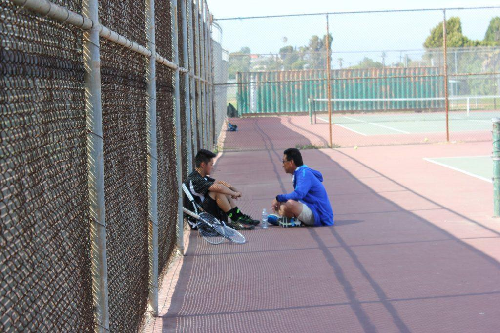 "Justin&squot;s father takes a moment to teach him a lesson while on the tennis court. ""It was such a powerful moment of coaching and fatherly love to me,"" Chai said."