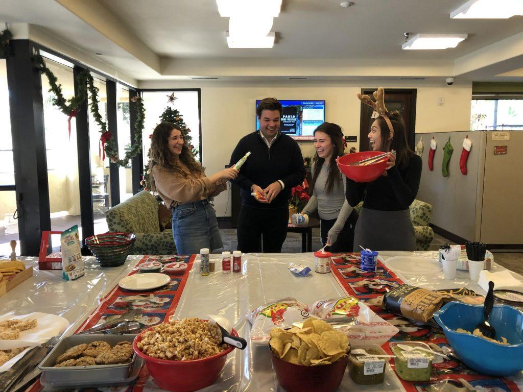 From left to right, Elise Sanchez, Jared Maguire, Lizzy Kovach and Sabrina Willsion celebrate the holidays at the Inter-Club Council holiday party. He said he made many meaningful friendships while being a part of ICC over the years.