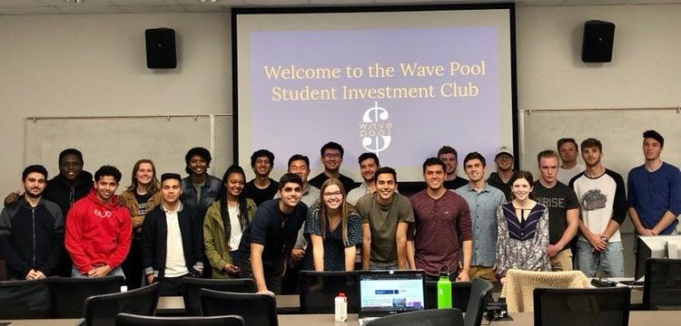 Members of the Wave Pool: Student Investment Club, which senior Jorge Contreras leads, smile for a group photo at one of their meetings. The Wave Pool sought a way to promote financial literacy and extend career opportunities in finance. Photo courtesy of Jorge Contreras