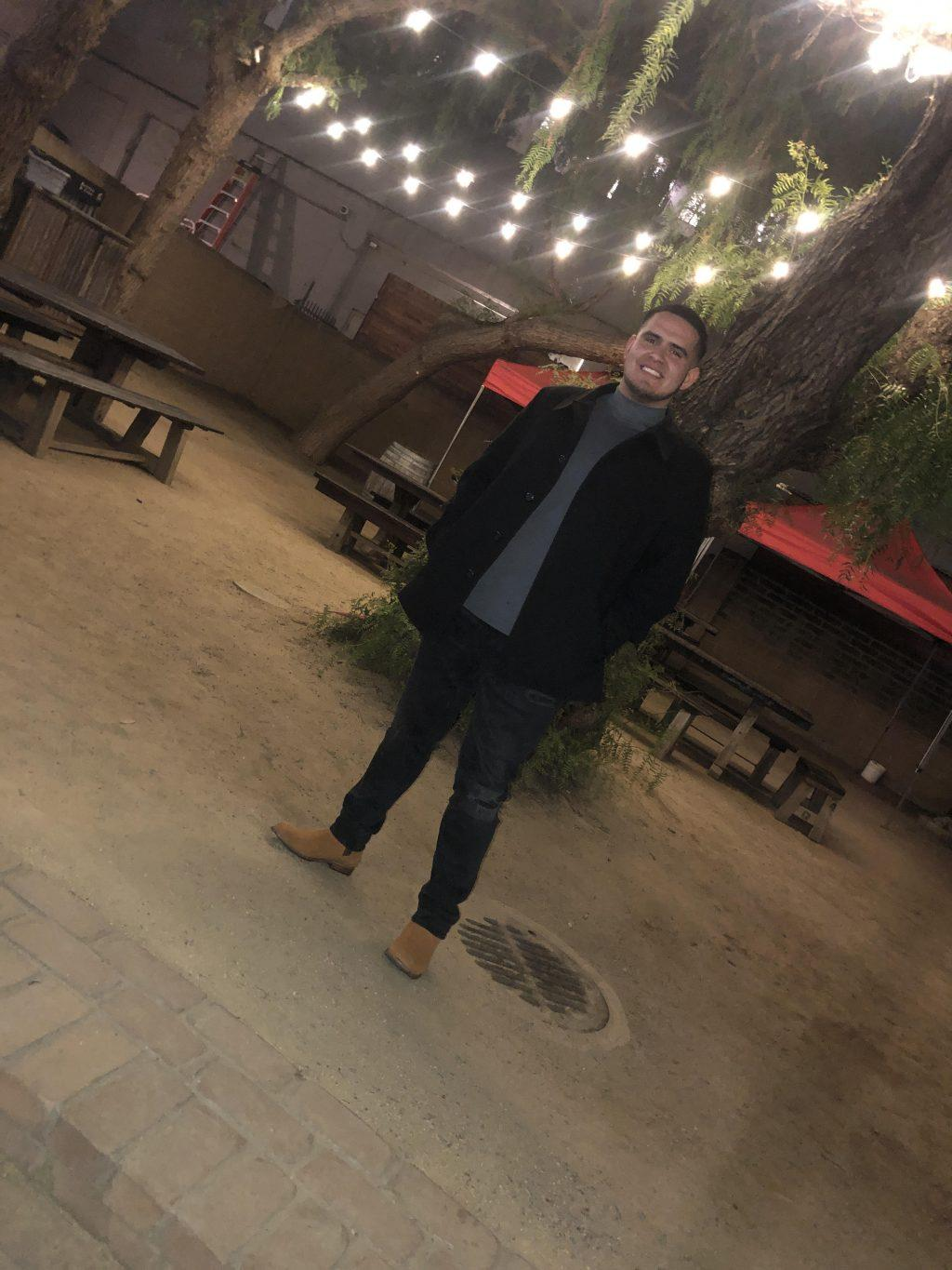 Garcia smiles in front of a restaurant. He said he hopes to make meaningful connections at Pepperdine.
