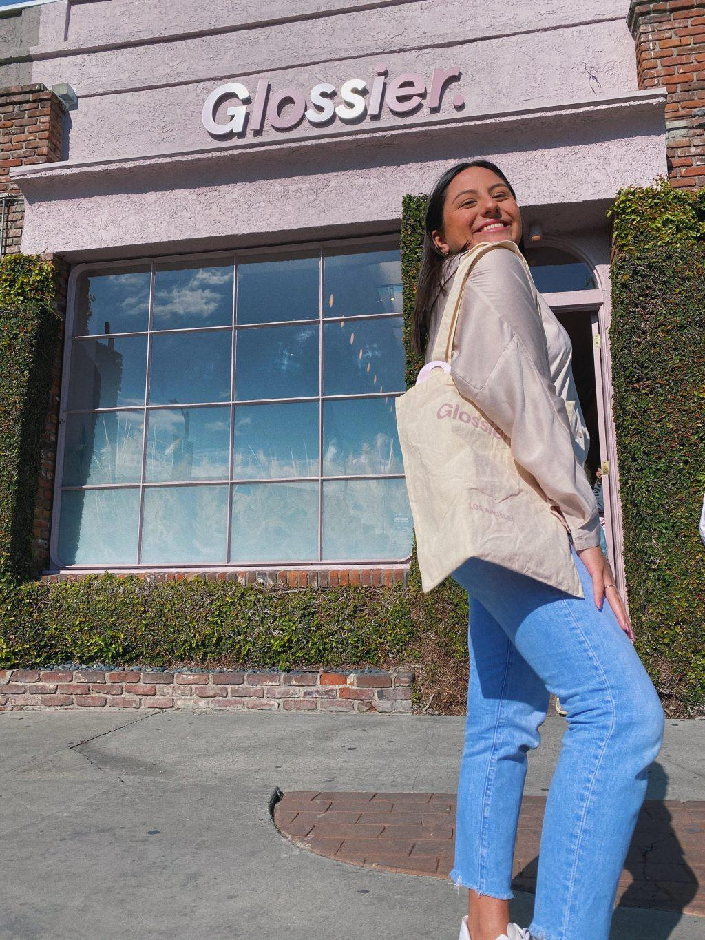 Hurtado pops a knee outside of the Glossier store on Melrose Place, a neighborhood in L.A.