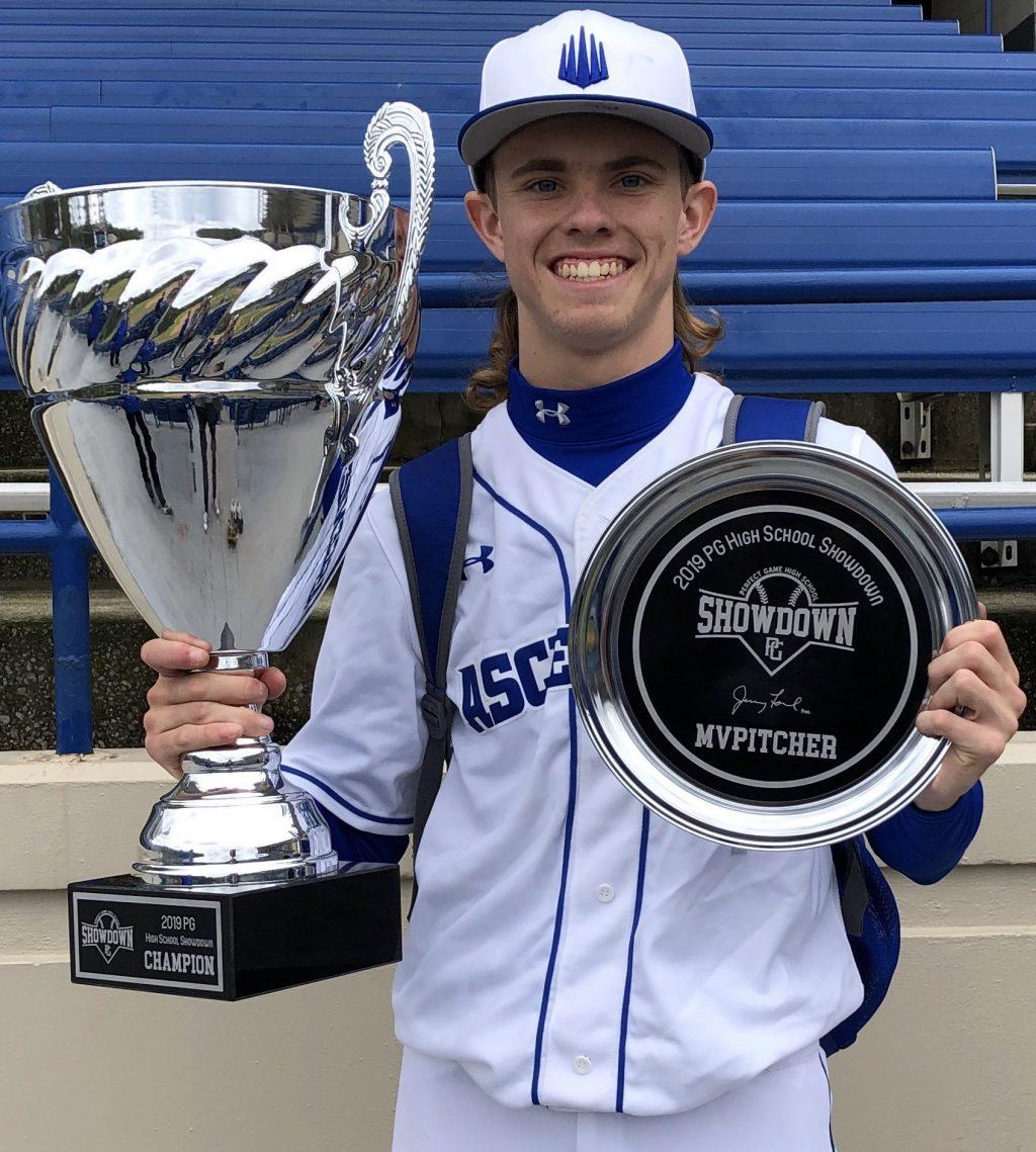 Llewellyn holds his team's 2019 national championship trophy and his MVP award for the best pitching performance of the tournament. Llewellyn has been a member of the prestigious IMG Academy national baseball team for the past two years.