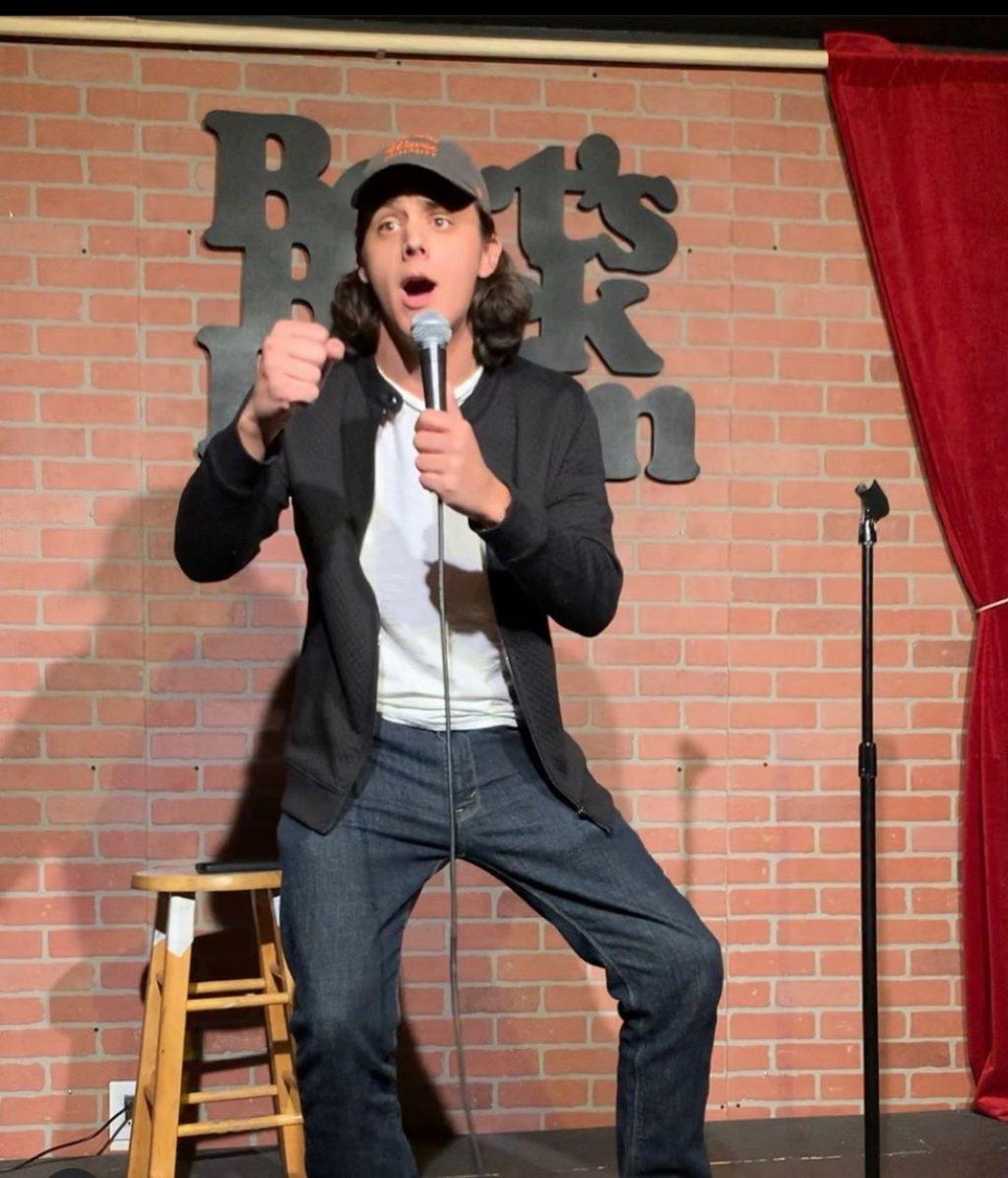 Senior Clayton Mattingly performs stand-up comedy at an open mic night at Bert's Backroom on Melrose Avenue. He has written his own material for his two-year stand-up comedy stint. Photo courtesy of Clayton Mattingly