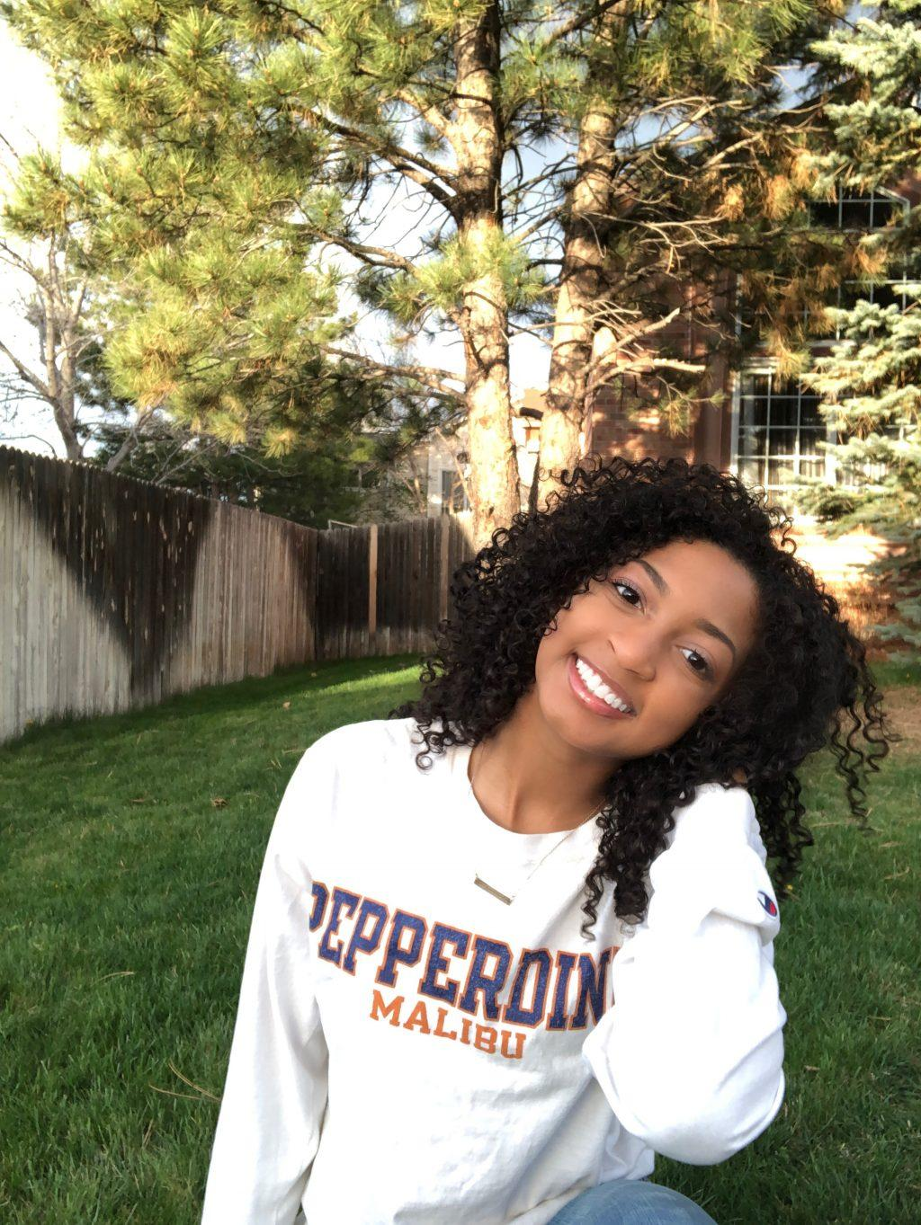 Biology major Pearson smiles, proudly sporting her Pepperdine gear in her backyard. She said she hopes to continue to grow her faith at the University.