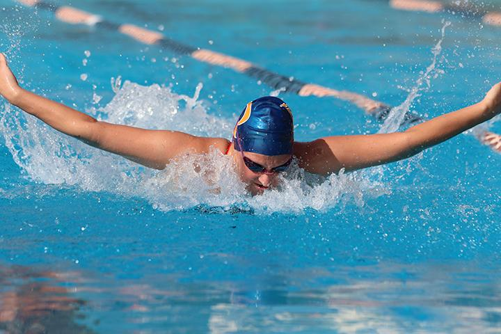 Sophomore swimmer Caroline Anderson competes in a meet last season. Anderson will be among the returning Waves looking to turn over a new leaf under head coach Ellie Monobe. File photo