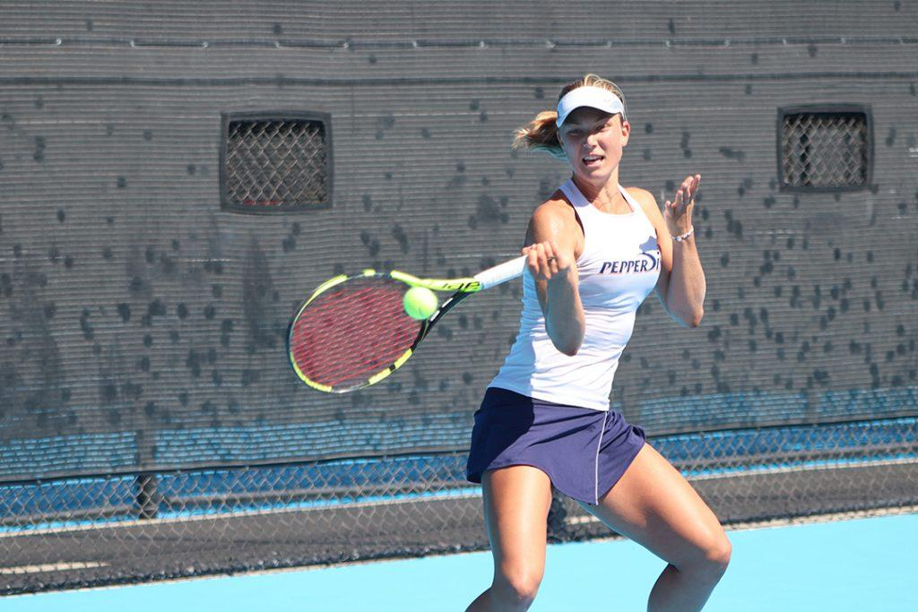 Ashley Lahey strikes a forehand at the Ralphs-Straus Tennis Center. Though Lahey took leave of absence from Pepperdine this semester, she will be back in the spring to compete for a national title in singles and with her team. File photo