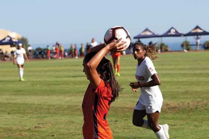Defender Laura Ishikawa looks to find a teammate for a throw-in during a 2019 victory against eventual national champions Stanford. As of now, no timetable has been released for when the 2020 season will begin. File photo
