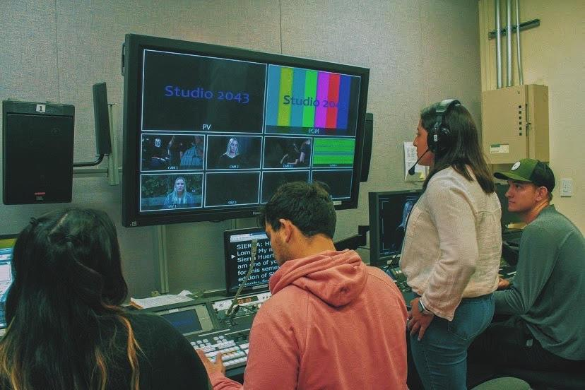 "Hurtado views a screen in PLNU&squot;s Point TV Studio. She directed a film in the first-year film show titled ""Studio 2043."""