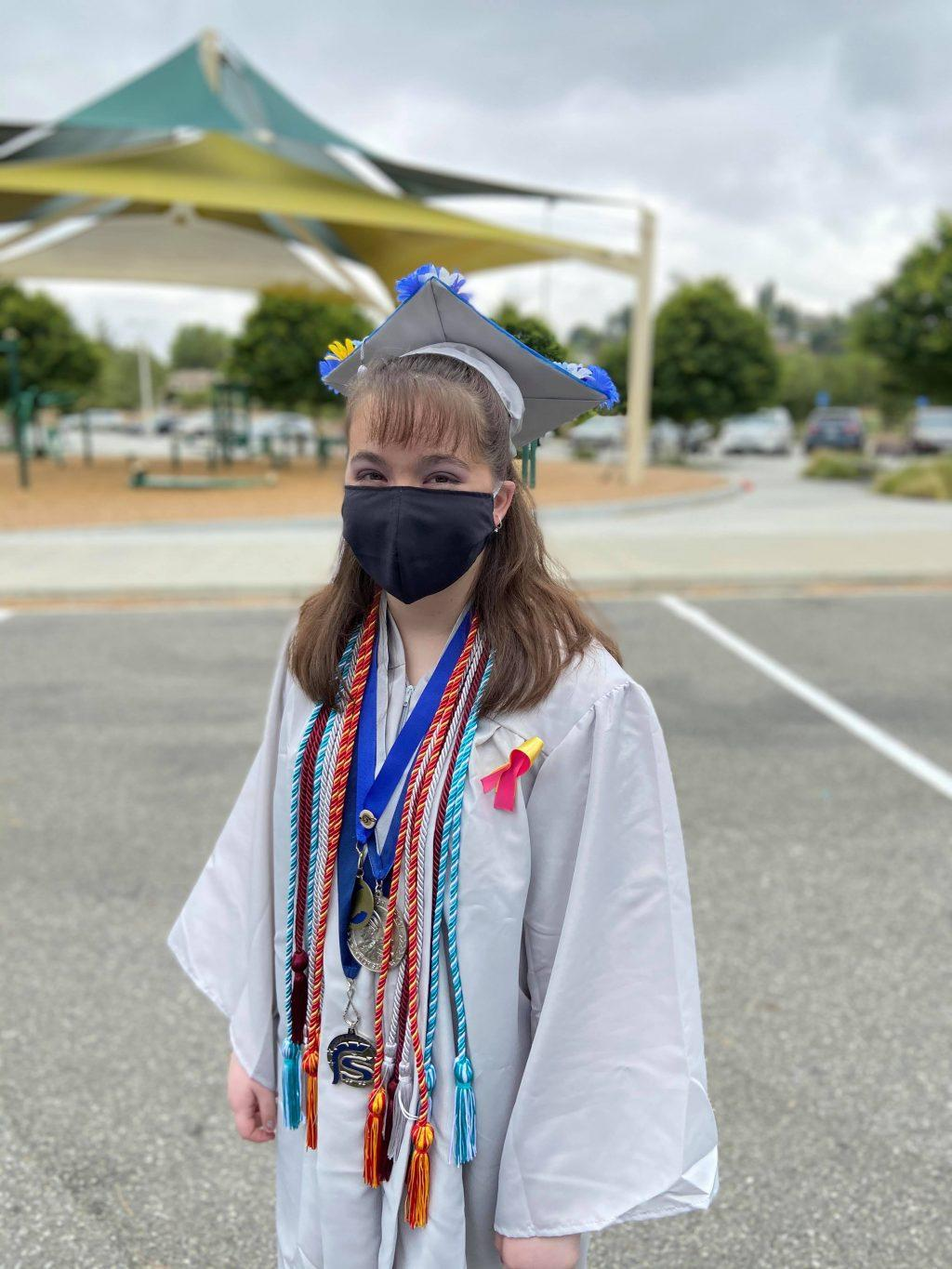 Then-high-school-senior Navia masks up before entering her socially-distant graduation ceremony from her Santa Clarita high school. Students were able to walk through the ceremony but were required to abide by COVID-19 restrictions.