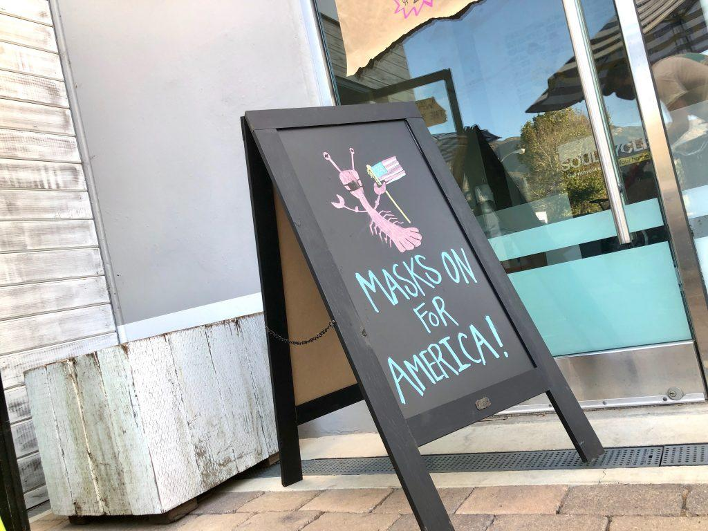 Broad Street Oyster Company displays a sign outside the restaurant asking customers to wear their masks.