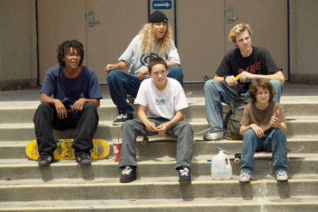 The skateboarders stay seated on the stairs of their favorite skate park after defying a cop's orders to leave.