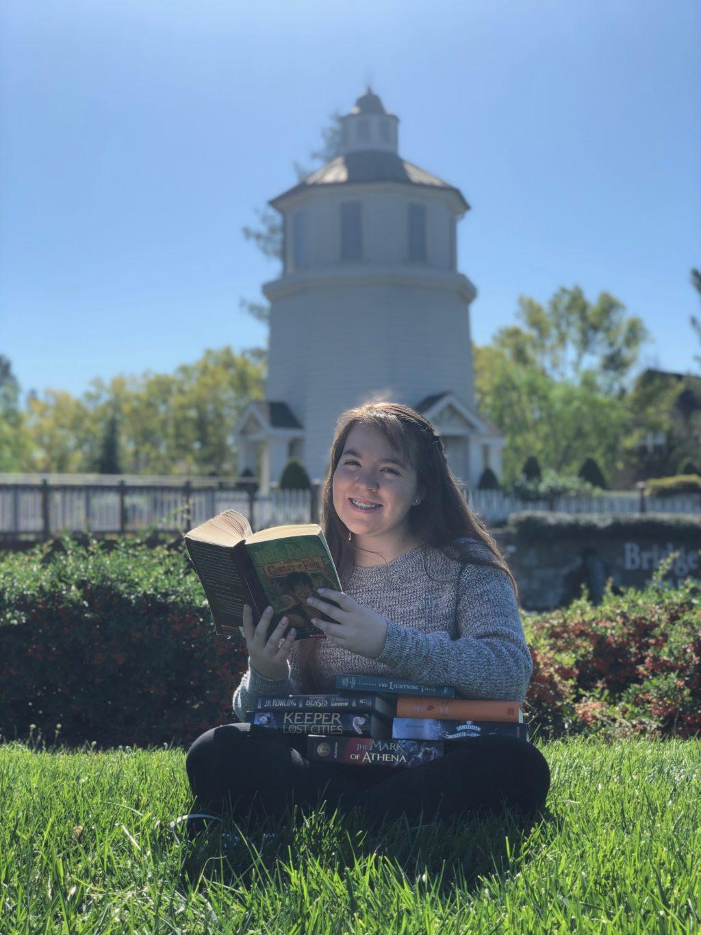 Reader Navia incorporated one of her interests, books, into her senior portraits.