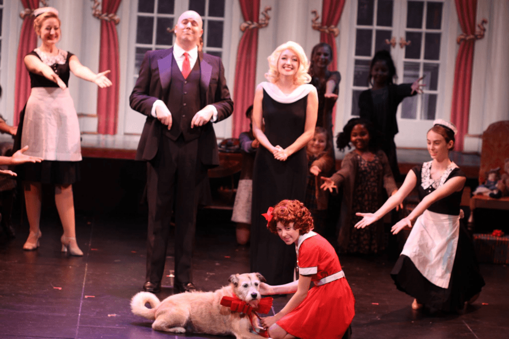 "Condolon (bottom right) performs in her first off-broadway show, ""Annie Warbucks"" — a sequel to the broadway show ""Annie."" She embodied the role of Annette the maid during her sophomore year of high school."