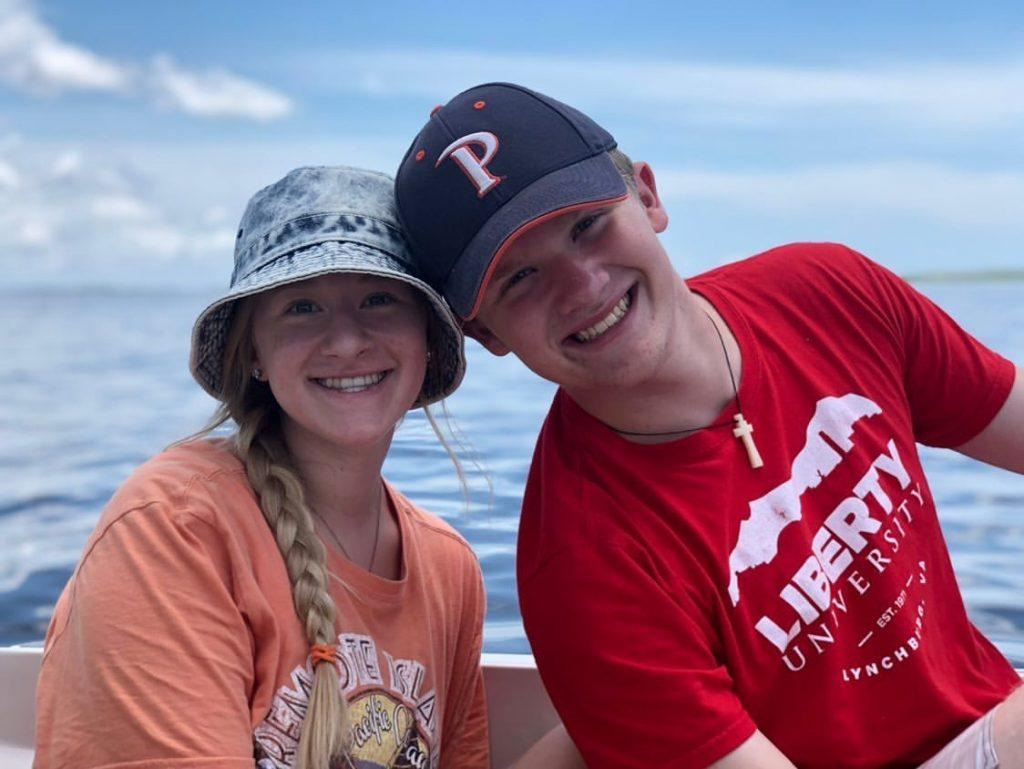 Ganey and his sister Ashley hang out on their grandpa's boat in North Carolina. The first-year represented his university by wearing a Pepperdine hat.