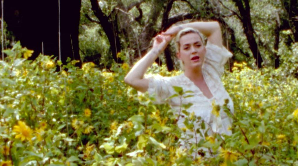 """Perry frolics through flowers in the music video for her single """"Daisies."""" The singer said this song inspired her to accept her past. Photo courtesy of Vevo"""