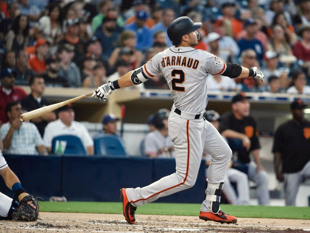 Utility infielder Chase d'Arnaud bats at a game when he was playing for the San Francisco Giants. One of d'Arnaud's fondest big league memories came when he pitched a scoreless for the Giants in 2018.