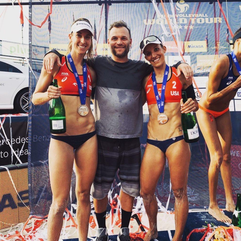Larsen (left) celebrates a tournament podium on the FIVB tour with teammate Emily Stockman (right). In their two years playing together, Larsen and Stockman have five podiums between AVP and FIVB events. Photo courtesy of Kelley Larsen