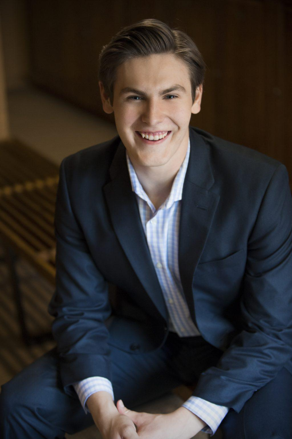 Senior Music major Liam Nixon smiles for a headshot at Taos Opera Institute in New Mexico during the summer. Nixon, a chamber choir singer, said his dream is to sing professionally, travel the world, perform opera in Europe and hopefully end up at the Met. Photo courtesy of Liam Nixon