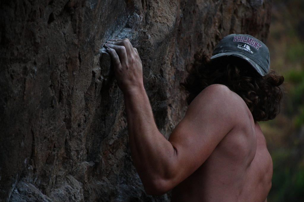 Sophomore John Palmer climbs the Espresso route at Echo Cliffs, California, in the summer of 2020. The climbing club decided to continue operating through the fall 2020 semester. Photo courtesy of Kyla Lucey