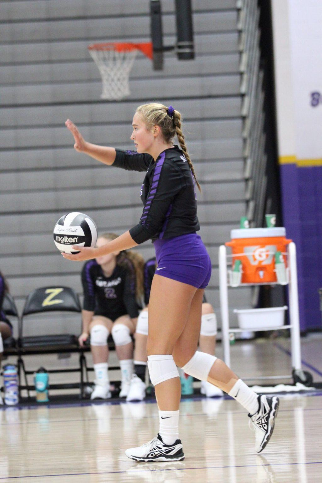 Steele prepares to serve in a game in the fall of 2019. Steele played in the defensive specialist and outside hitter positions during her high school career in Henderson, Nevada. Photo courtesy of Kennedi Steele