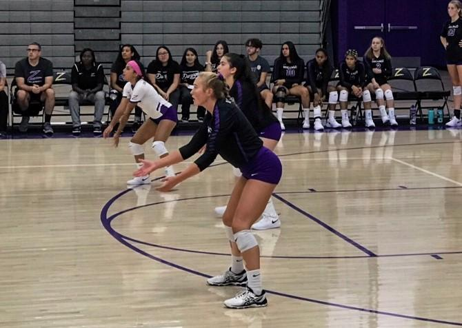 Defensive specialist Kennedi Steele prepares to receive a serve in a match from her senior year in the fall of 2019. Steele planned to play volleyball this fall but is one of many freshmen student-athletes studying from home this semester. Photo courtesy of Kennedi Steele