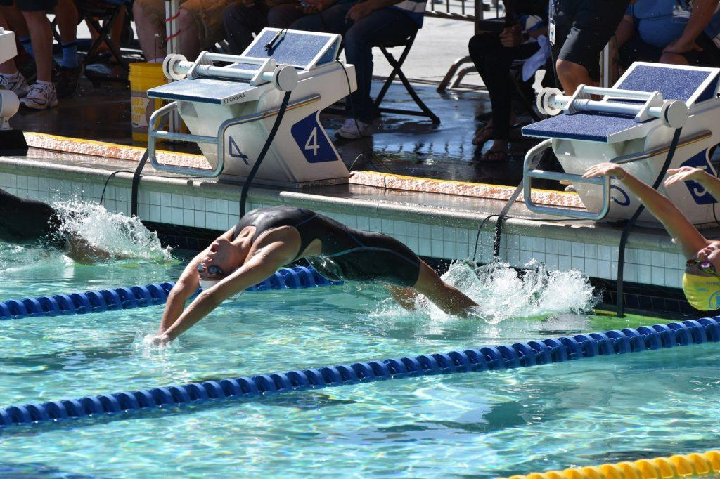Freshman swimmer Tay Thomas competes in a fall 2019 swim meet. Thomas has been living on campus since August. Photo courtesy of Tay Thomas