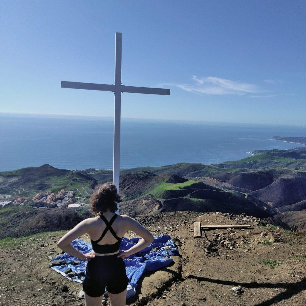 Nature-loving junior Angelea Hayes reaches the end of her hike to the cross, sat atop the Pepperdine Malibu campus. Hayes said nature is her happy place and plans to hike this trail many times before she graduates. Photo courtesy of Angelea Hayes