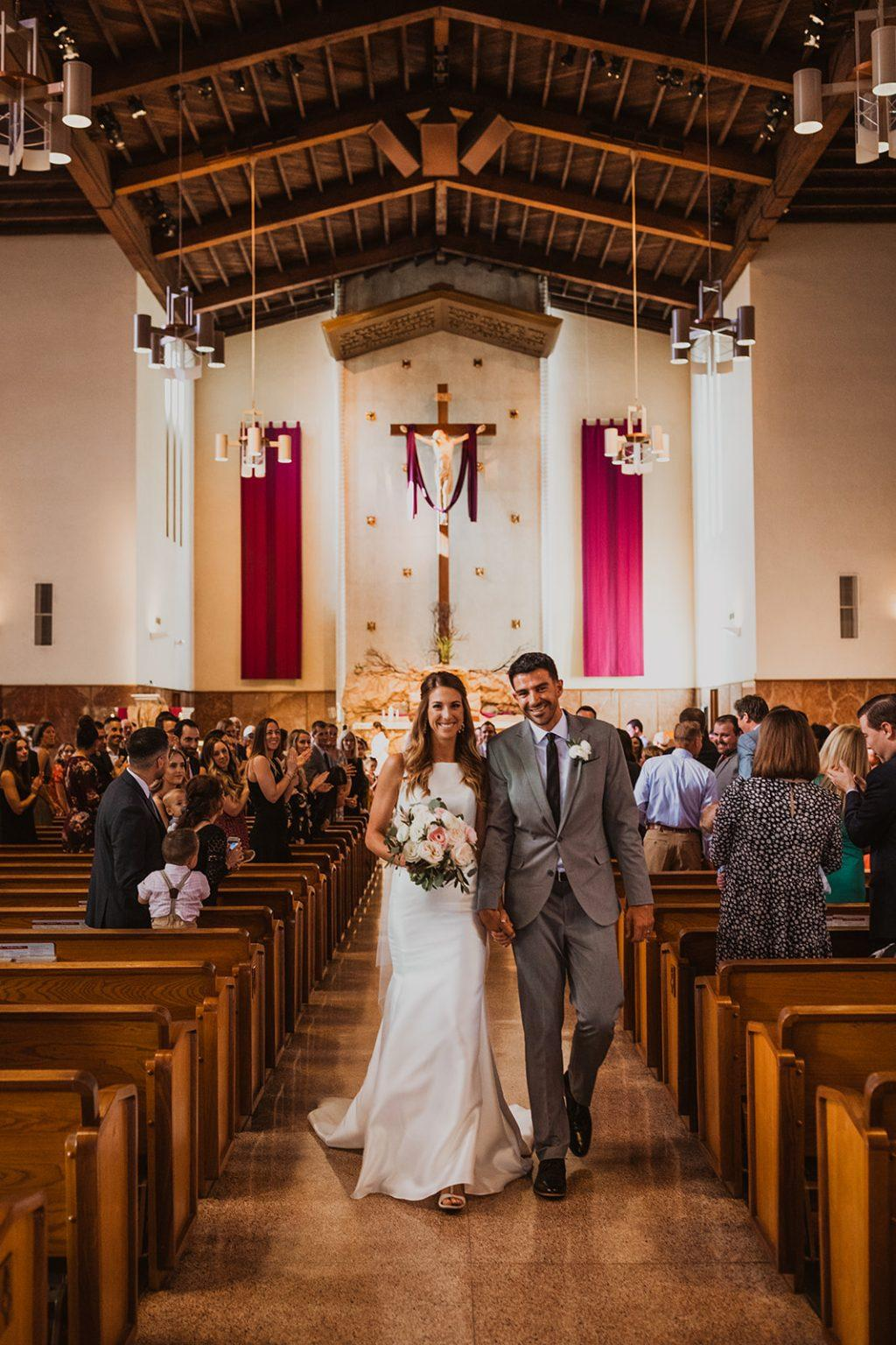 Larsen and her AVP tour pro husband, Bill Kolinske, walk down the aisle at their wedding this year. The two pro players got engaged at center court during a tournament in 2019. Photo courtesy of Kelley Larsen
