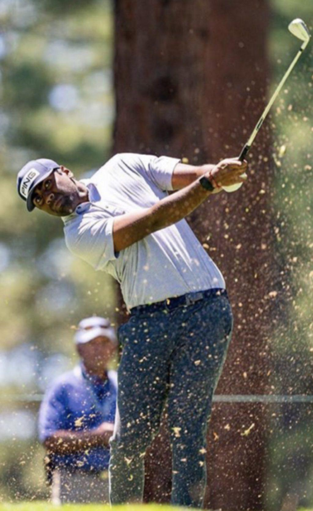 Pro golfer Theegala swings his 9 iron toward the 10th green during the Barracuda Championship on Tahoe Mountain Club's Old Greenwood Course in Truckee, CA. He tied for 41st in the tournament.