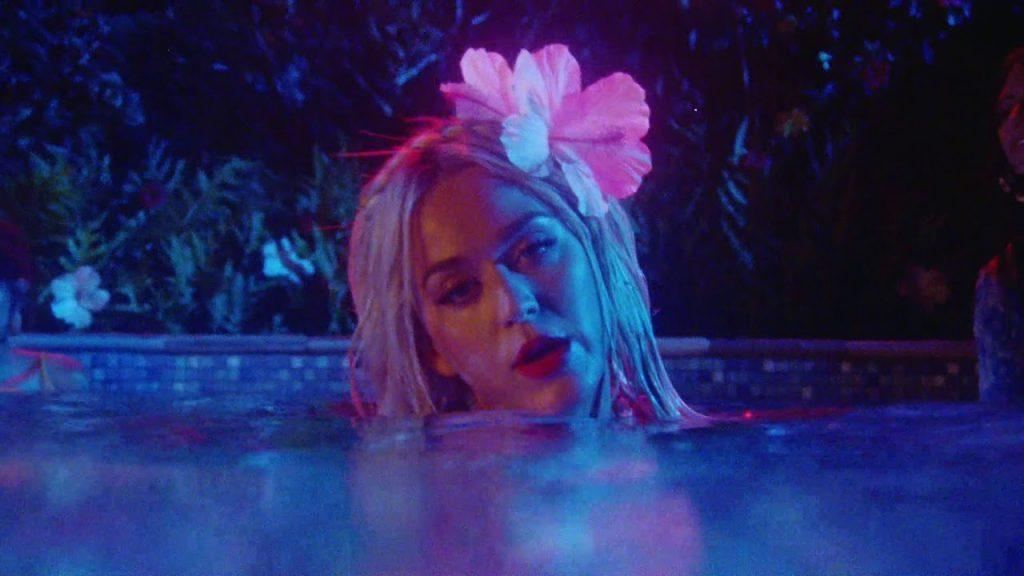 """Perry&squot;s """"Harleys in Hawaii"""" music video features the singer bathing in neon lights and steamy water. This R&B song immersed the listeners into Perry&squot;s fantastical exotic island romance. Photo courtesy of Vevo"""